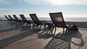 A row of deck chairs by a beach